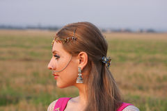 Profile of a woman with Indian jewelry Stock Photography