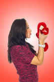 Profile of woman kissing heart toy Royalty Free Stock Image
