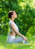 Profile of woman in lotus position Royalty Free Stock Photography