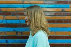 Profile of woman near colorful wall outdoors royalty free stock photo