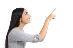 Profile of a woman pointing an advertisement. Isolated on a white background Stock Photos