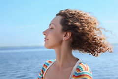 Profile of woman on sea. Profile of woman of which in face blows marine wind stock image