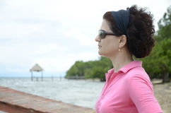 Profile of woman by the sea Stock Images