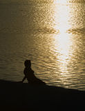 Profile of a woman silhouette watching sun on the Royalty Free Stock Photo