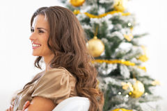 Profile woman sitting near christmas tree Stock Photography