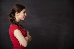 Profile of Woman smiling blackboard