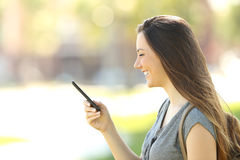 Profile of a woman using a mobile phone Stock Photos