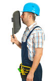 Profile of worker man with welding mask Stock Image