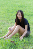 Profile of a young Asian woman in Lawn Stock Photography