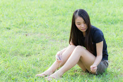 Profile of a young Asian woman in Lawn Royalty Free Stock Images