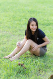 Profile of a young Asian woman in Lawn Stock Images