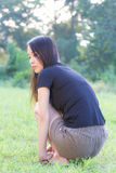 Profile of a young Asian woman rimlight in Lawn Stock Image