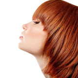Profile of young beautiful redheaded teen girl. Isolated on white background Royalty Free Stock Photography