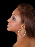 Profile of young black woman with earring Stock Image