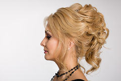 Profile of young blonde girl Stock Images