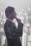Profile of young businessman contemplating, double exposure of cityscape, Beijing Royalty Free Stock Image