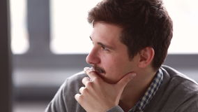 Profile of young businessman talking in meeting