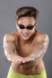 Profile of young , caucasian athlete swimmer with goggles in sta. Rt position Royalty Free Stock Image