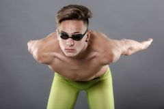 Profile of young , caucasian athlete swimmer with goggles in sta. Rt position Royalty Free Stock Images