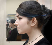 Profile of young girl with black hair Stock Images