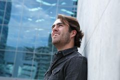 Profile of a young man smiling outside Stock Photography