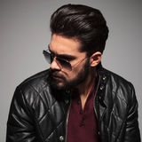 Profile of a young man in sunglasses and leather jacket Stock Photography