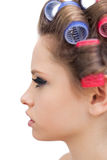 Profile of young model with hair curlers Stock Photography