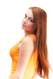 Profile of a young red-haired girl in a bright shirt. Isolated o Royalty Free Stock Photography