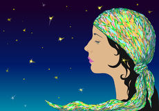 Profile of a young romantic girl in a motley kerchief. Against the starry sky Royalty Free Stock Image