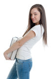 Profile of young serious woman carrying books Stock Photo