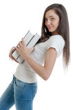 Profile of young woman carrying books Royalty Free Stock Photo