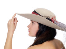 Profile of young woman with finger to hat Stock Image