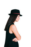 Profile of young woman in a hat. Profile of stylish young woman in a hat looking down, isolated on white background stock image