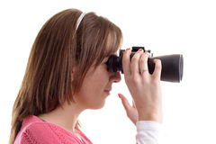 Profile of young woman looking trough binoculars Royalty Free Stock Image