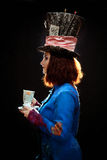 Profile of young woman in the similitude of the Hatter. (Alice's Adventures in Wonderland stock photo