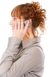 Profile of young woman which speaks by phone Royalty Free Stock Photos