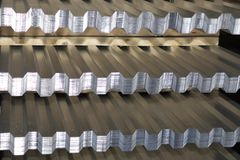 Profiled galvanized sheet in packs at the metal products warehouse royalty free stock image