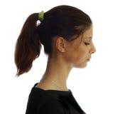 Profilera av en ung flicka Arkivfoto