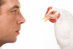 Profiles of man and hen Stock Photos