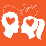 Profiles of man and woman connected by love wire Stock Images