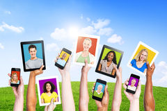 Profiles of Multiethnic People in Electronic Devices Royalty Free Stock Photo