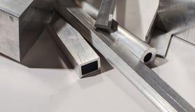 Profili e tubi del metallo Fotografia Stock