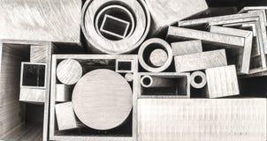 Profili e tubi del metallo Immagine Stock