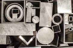 Profili e tubi del metallo Fotografie Stock Libere da Diritti