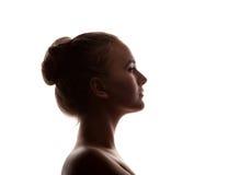 Profilo del ritratto della donna nell'ombra della siluetta fotografia stock libera da diritti