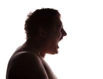 Profilo della siluetta del ritratto dell'uomo che grida Fotografia Stock Libera da Diritti