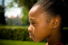 Profilo delle giovani ragazze dell'afroamericano Immagine Stock