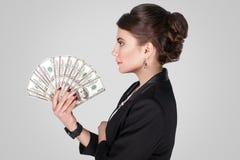Profilowy boczny bizneswoman, trzyma gotówkę wiele Zdjęcie Royalty Free