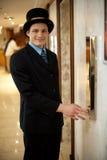 Profilowy strzał doorman w dęciaka kapeluszu Obraz Royalty Free