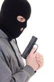 Profilowy widok kryminalny mężczyzna w maskowym mienie pistolecie odizolowywającym na whi Fotografia Stock